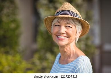 Portrait of a happy senior woman in straw hat