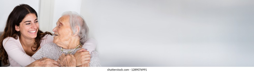 Portrait Of Happy Senior Woman And Young Granddaughter