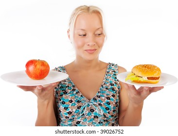 Portrait of happy sexy woman making choice between food