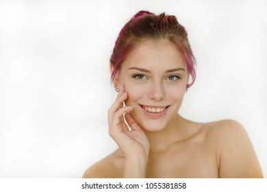 Portrait of a happy and sexy young beautiful woman with bare shoulders looking with a smile at the camera touching a person's hand isolated on a white background. Beauty concept