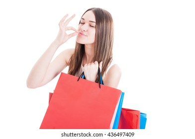 Portrait of happy shopaholic girl gesturing a perfect sign as excitement and satisfaction concept isolated on white background