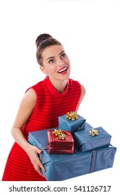 Portrait of happy shopping girl holding gift boxes. New year. Isolated on white