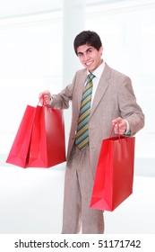 Portrait of a happy shopping man
