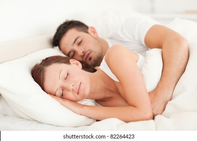 Portrait of a happy Sleeping couple in their bedroom