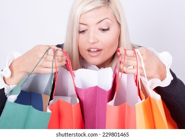 Portrait of happy smile beautiful woman with colorful shopping bags in her hands