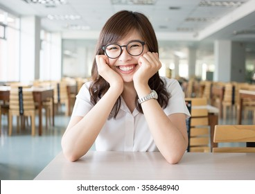 portrait of happy and smile woman asian student with uniform in classroom at library of main campus in university. Happy and relax student in academic, education and school study concept
