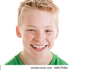 Portrait of happy smiling 12 year old boy isolated on white background