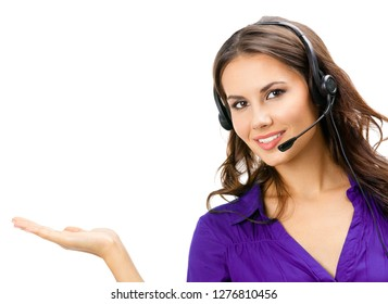 Portrait of happy smiling beautiful young support phone operator showing something or copyspase for product or some sign text, isolated against white background
