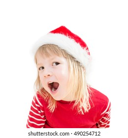 portrait of happy smiling blond girl in preschool age wearing santa claus costume, dressed as christmas elf, child looking satisfied and wicked, isolated on white background