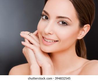 Portrait of a happy smiling brunette makeup beauty.