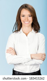 Portrait of happy smiling business woman, over blue background