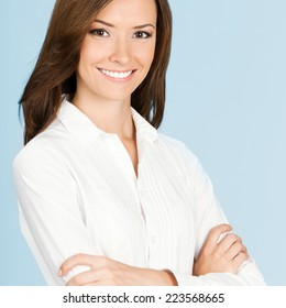 Portrait of happy smiling business woman, over grey background