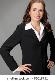 Portrait of happy smiling business woman, over gray background