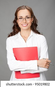 Portrait of happy smiling business woman with red folder, over gray background