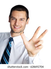 Portrait of happy smiling businessman showing three fingers, isolated on white background. Success in business, job and education concept shot.