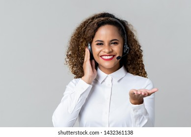Portrait of happy smiling cheerful African American woman customer support phone operator in headset over gray background