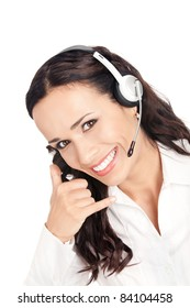 Portrait of happy smiling cheerful customer support phone operator in headset with call me gesture, isolated on white background