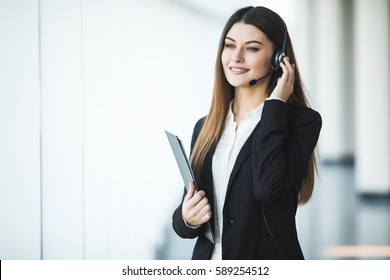 Portrait of happy smiling cheerful support phone operator in headset,
