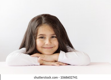 Portrait of happy smiling child girl isolated on white background