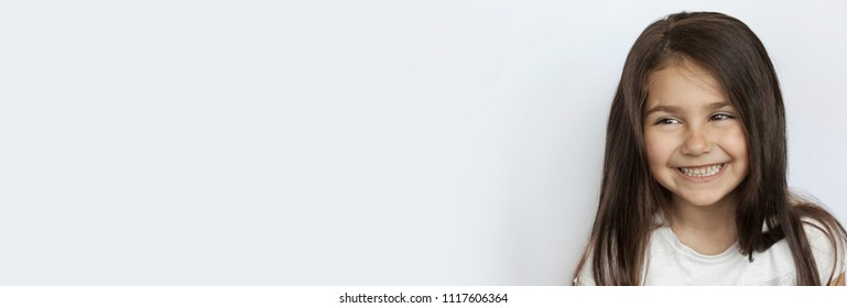 Portrait of happy smiling child girl. Panoramic banner.