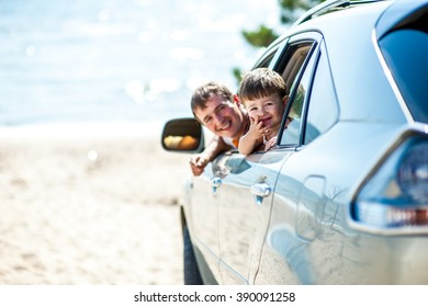 Portrait happy, smiling Family, father, one kid sitting in the white, silver car looking out windows, ready for vacation trip, outdoor background. Positive Human face expression, emotions, feelings