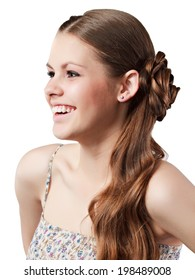 Portrait of the happy smiling girl with brown hair posing in studio.
