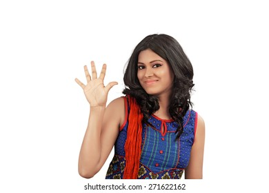 Portrait of happy smiling indian woman showing five fingers, isolated over white background