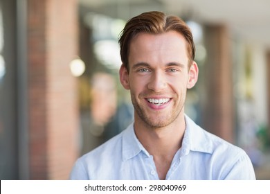 Portrait of happy smiling man at the mall