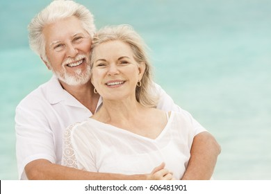 Portrait happy smiling retired senior Caucasian couple in love living a healthy outdoor island lifestyle on Caribbean beach
