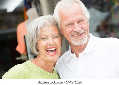 Portrait from a happy and smiling senior couple