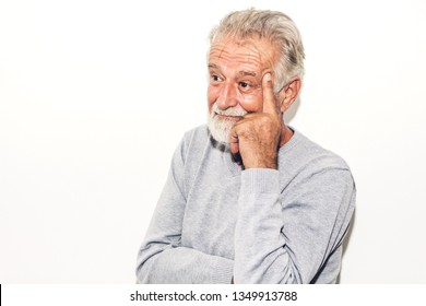 Portrait of happy smiling senior man looking at camera while standing on white background