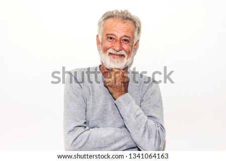 21cf25dd91 Portrait of happy smiling senior man looking at camera while standing on  white background