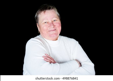 Portrait of happy and smiling senior woman in photo studio isolated on black background