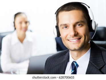 Portrait of happy smiling support phone operator at workplace. Call center and customer service concept.