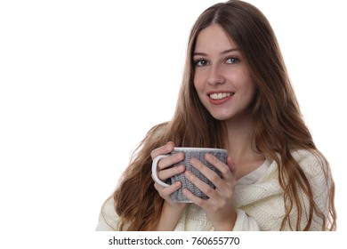 Portrait of happy smiling teenage girl covered with a blanket holding cozy mug isolated od white backgroud