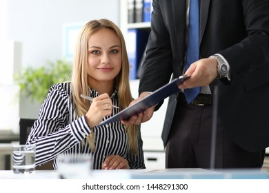 Portrait of happy smiling woman. Beautiful biz lady signing profitable contract and looking at camera with gladness. Business concept. Blurred background