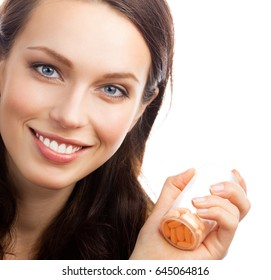 Portrait of happy smiling woman showing bottle with pills, isolated over white background. Healthcare and medicare concept shot.