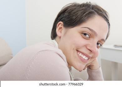 Portrait of a happy smiling young adult  latina woman looking to the camera