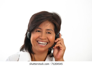 portrait of a happy smiling young Asian woman with a headset