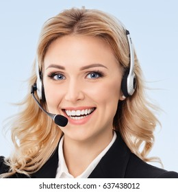 Portrait of happy smiling young support phone operator or businesswomen in headset, on blue background. Success in business, job and education concept. Square