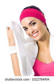 Portrait of happy smiling young woman in red fitness wear with towel, isolated on white background