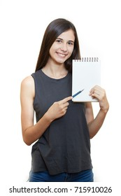 Portrait of happy smiling young woman isolated over white background. Holds a notepad and pencil