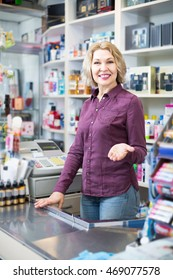 Portrait of happy spanish mature store clerk at household and cosmetic shop