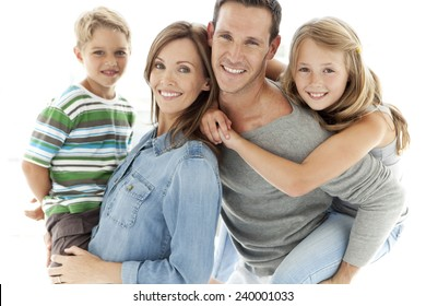 Portrait of a happy standard Caucasian family with two kids