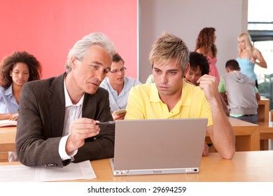 Portrait of happy student with lecturer in a classroom