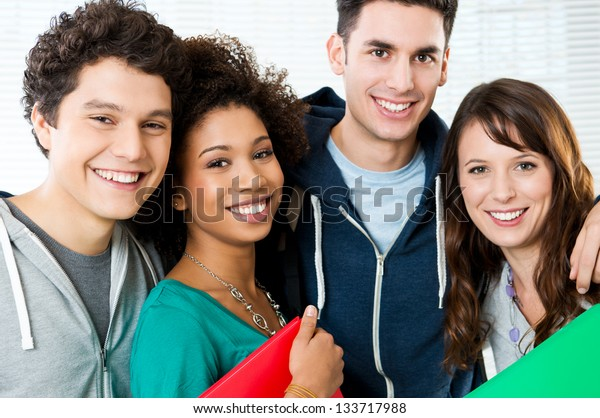 Portrait of happy students together at college