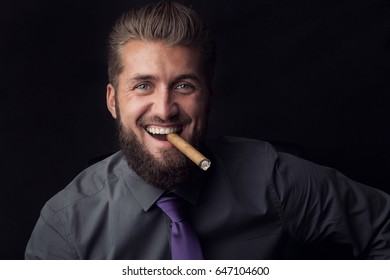 Portrait of a happy successful businessman with a cigar in his mouth