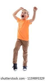 PORTRAIT OF HAPPY SURPRISED LITTLE BOY STANDING SHOUTING BY CHEER AND SMILING WITH HANDS UP ISOLATED ON WHITE BACKGROUND