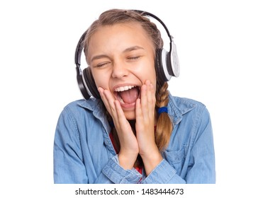 Portrait of happy teen girl with headphones, isolated on white background. Cheerful beautiful child listening to music and singing song. Emotional portrait of cute caucasian teenager enjoying music.