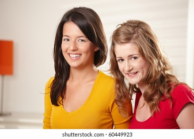Portrait of happy teenage girls smiling together looking at camera.